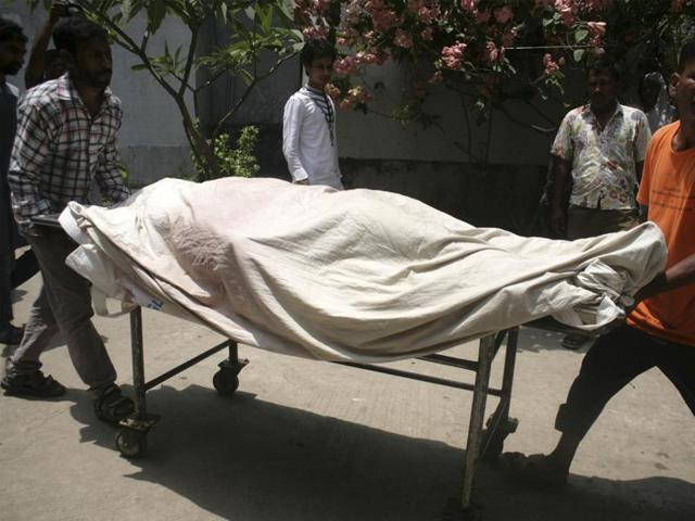 Bangladeshi medical assistants move a trolley with the body of activist Mahbub Tonoy at a hospital in Dhaka. Two leading gay rights activists were also hacked to death on April 25.