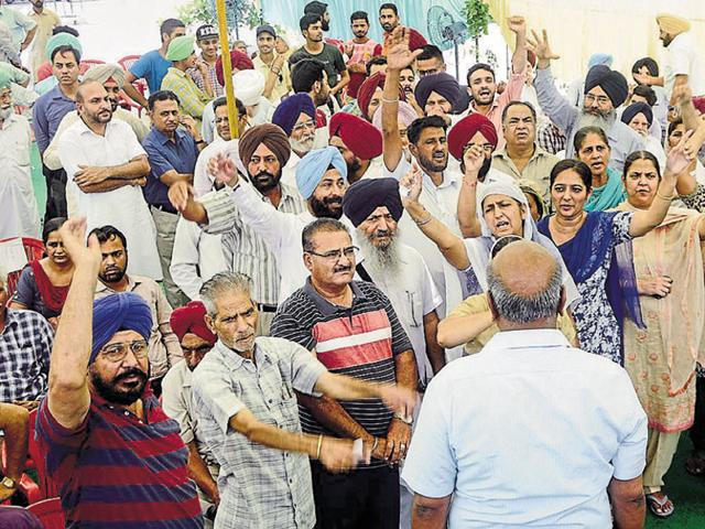 Residents protesting during the auction of plots in the Housefed colony in Bathinda on Friday.