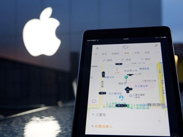 """Apple CEOTim Cook said that investing in the leading Chinese ride sharing service could expand its presence in that """"very, very important"""" market, and serve other ends as well"""