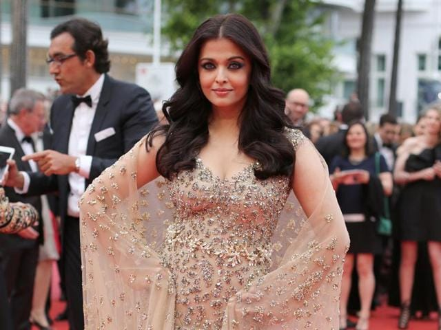 Aishwarya Rai Bachchan poses for photographers upon arrival at the screening of the film Ma Loute (Slack Bay) at the 69th international film festival, Cannes, southern France. Fashion designers back home are divided on her sartorial choice.