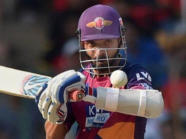 Pune Supergiants batsman Ajinkiya Rahane plays a shot during the IPL T20 match against Royal Challengers.