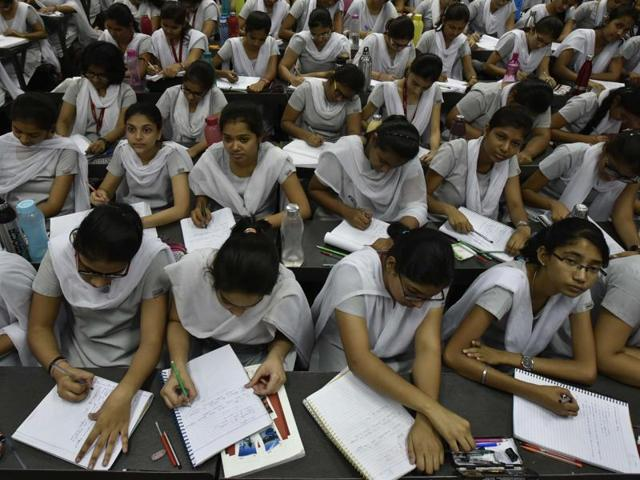 Students take notes in at Allen Career Institute, the leading coaching institute in Kota, Rajasthan. It claims to have enrolled over 77,000 students last year.(Raj K Raj / Hindustan Times)