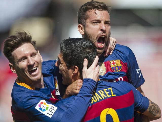 FC Barcelona's Luis Alberto Suarez from Uruguay, center, celebrates scoring against Granada.