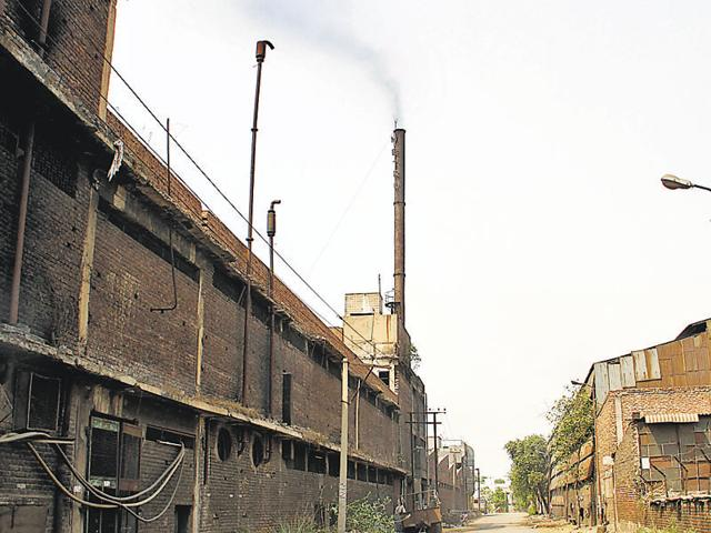 Chimneys emitting harmful gasses at Focal Point in Ludhiana on Friday.