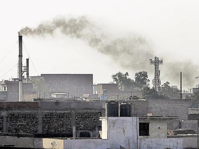 Smoke billows out of a factory at Focal Point in Ludhiana.