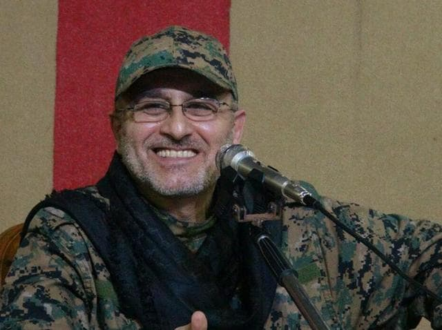 This undated handout image released on May 13, 2016 by Hezbollah shows slain top military commander Mustafa Badreddine smiling during a meeting.