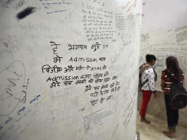 The wall of the Radha Krishna temple in Kota where students scribble their wishes in the hope that their prayers will be answered. One recurring prayer is for admission to the IIT, as seen in this photograph