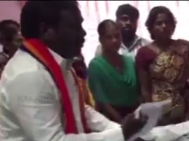 PMK's K Balu showered currency notes on an election  official alleging 'inaction'.