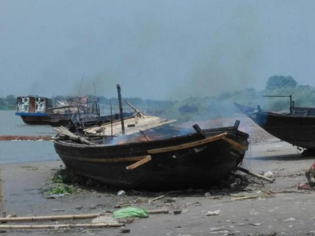 One of the vessels set afire by local residents, who were angered by the delay in launching rescue operations  after a boat capsize in Nadia on Saturday night.