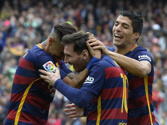 Lionel Messi (C) celebrates with Neymar and Luis Suarez (R) after scoring a goal during the La Liga match between Barcelona and RCD Espanyol at the Camp Nou stadium in Barcelona on May 8, 2016.