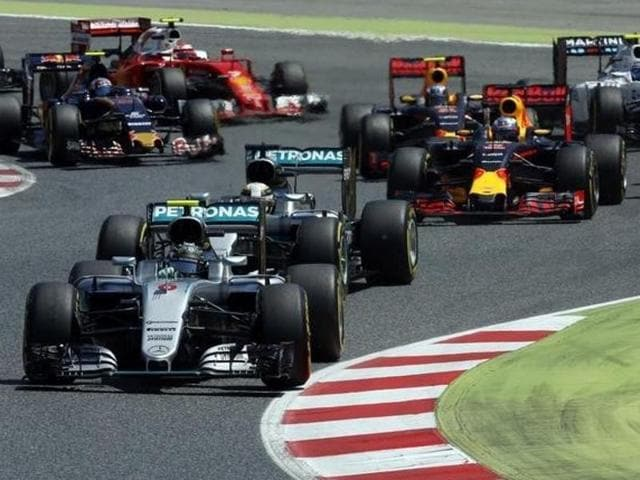 Mercedes AMG Petronas F1 Team's British driver Lewis Hamilton (L) and  Nico Rosberg lead after the start.