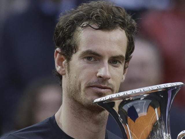 Andy Murray holds the trophy after beating Novak Djokovic 6-3, 6-3 in the final match of the Italian Open.