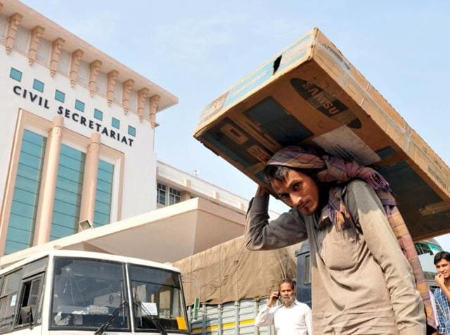 Labourers carry official documents of a civil secretariat to load them on a truck during an annual darbar move from Jammu to Srinagar, last year.