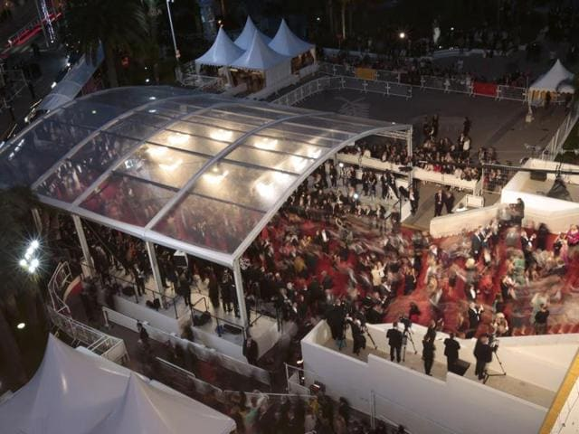 Spectators walk on the red carpet as they arrive for the screening of the film Ma loute (Slack Bay) in competition at the 69th Cannes Film Festival in Cannes, France.