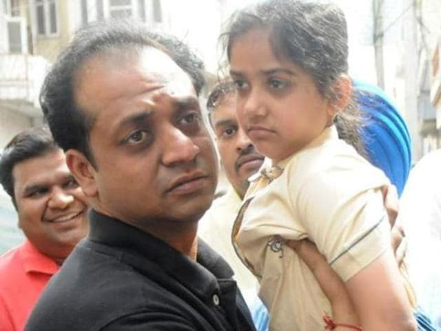 File photo of Shanvi with father Amit Gupta after her release in Patiala.