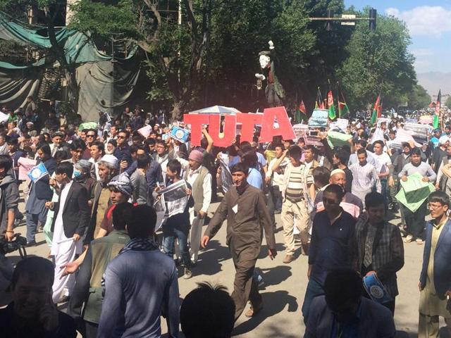 Crowds gather on the street in Kabul, Afghanistan for a massive anti-government protest Monday, May 16, 2016. Authorities locked down Afghanistan's capital Monday as tens of thousands of members of an ethnic minority group marched through the streets to protest the proposed route of a power line.