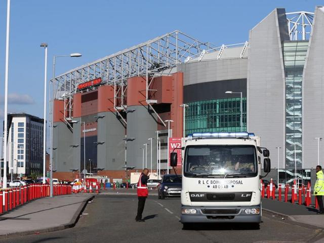 Police with sniffer dogs outside the Old Trafford stadium after fans were evacuated and a game between Manchester United and Bournemouth was abandoned when a suspicious package was found in a toilet.