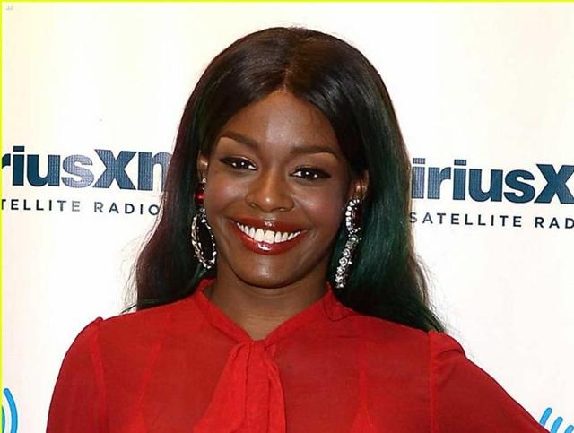 Rapper Azealia Banks has apologised for her racist slur against Zayn Malik.