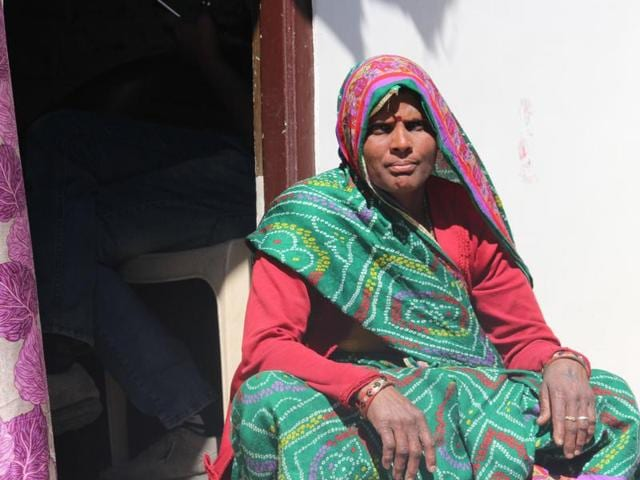 Dev Kor outside her house in a slum of Indore.