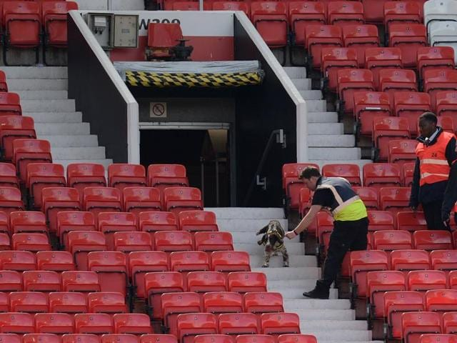 A sniffer dog searches the stands after fans evacuated Old Trafford stadium in Manchester, on May 15, 2016, after the Premier League football match between Manchester United and Bournemouth was abandoned.