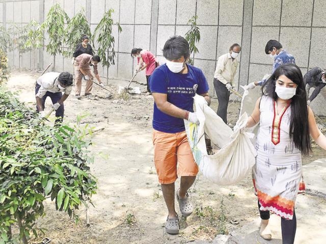 Volunteers at work at Swami Sivananda Memorial Institute on Sunday.