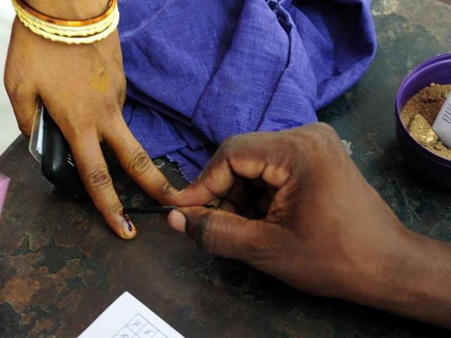 Voters wait to cast their ballots at a polling station in Chennai.