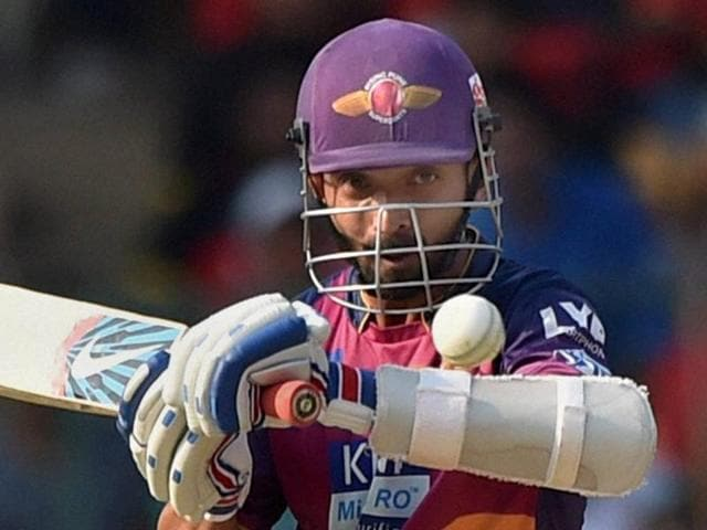 Rising Pune Supergiants batsman Ajinkiya Rahane plays a shot during the IPL T20 match.