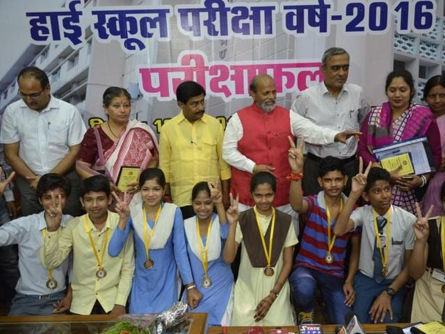 Education minister Paras Jain felicitating MP board high school examination topper Mukesh Chandel in Bhopal on Monday.