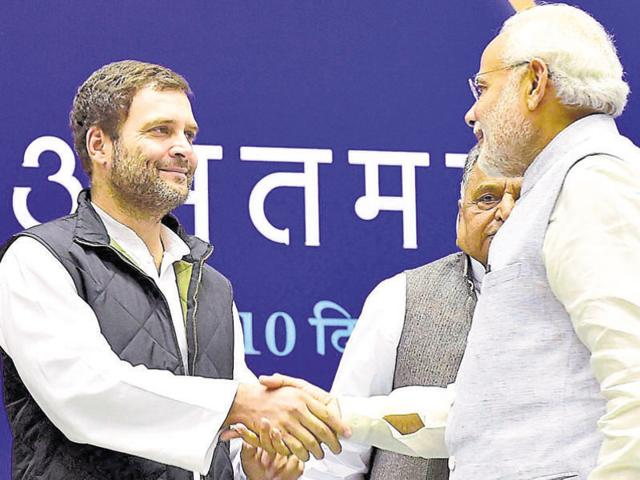 Prime Minister Narendra Modi shakes hands with Congress vice-president Rahul Gandhi during a function at Vigyan Bhawan in New Delhi.