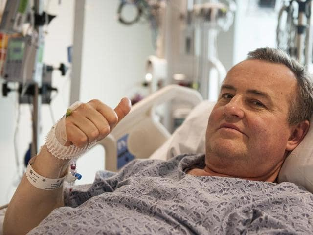 In this file photo provided by Massachusetts General Hospital, Thomas Manning gives a thumbs up after being asked how he was feeling following the first penis transplant in the United States.