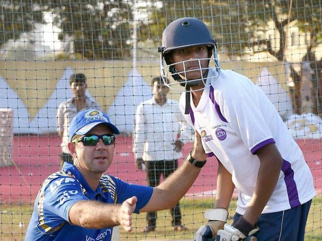 Mumbai Indians' team members and support staff during a coaching clinic in Mumbai on Monday.
