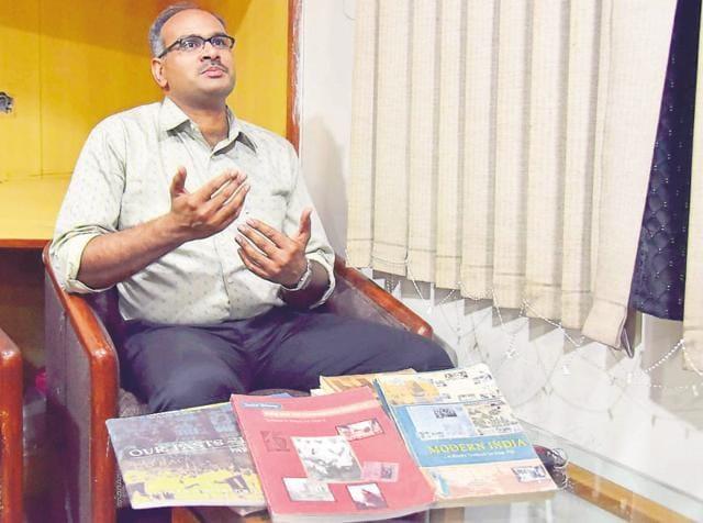 RTI activist S P Singh with NCERT textbooks.