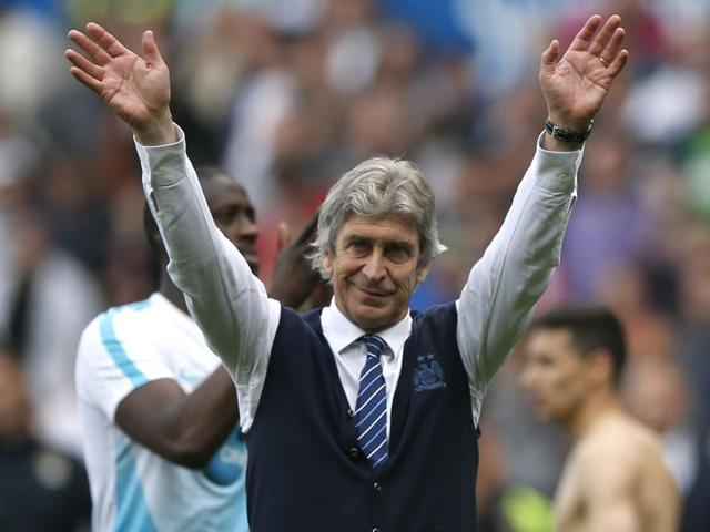 Manuel Pellegrini waves to fans at the end of his last match in charge of Manchester City.