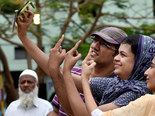 Voters take selfie after casting votes for the Tamil Nadu assembly polls in Chennai on Monday.