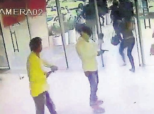 Screen grabs from the footage of the incident. Scared customers ran out the nearest exit once the firing started. Gunmen were seen kicking some of the customers as they escaped. According to the police, one person was injured when he hit a table while running out. The pub owner said a discotheque he operated earlier was also attacked in 2015 over extortion demands.
