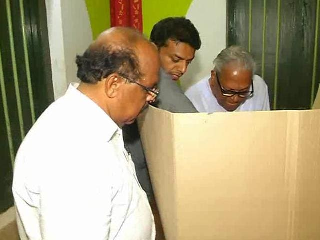 CPM candidate G Sudhakaran looking on as VS Achuthanandan casts his vote during the Kerala assembly elections on May 16, 2016.