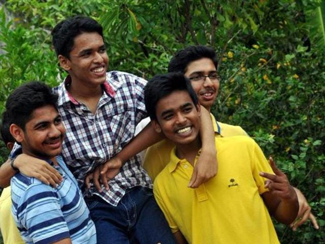BS Ranjan (second from left), a student from Bhadravathi in Karnataka's Shivamogga district scored 625 out of 625 marks in the Karnataka state board SSLC examinations.