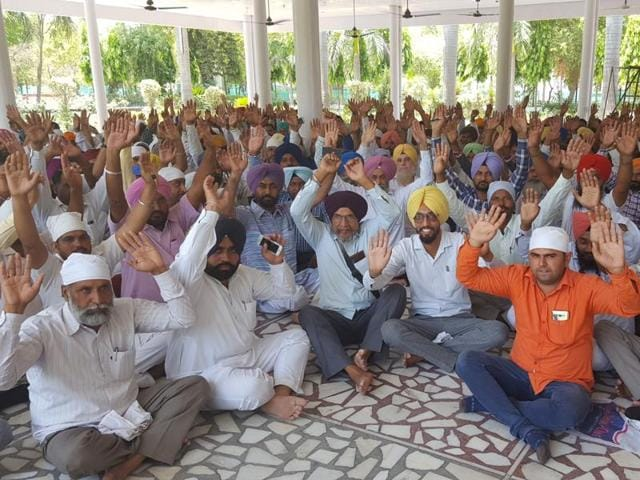 Investors protesting against the chit fund company in Ferozepur on Monday.