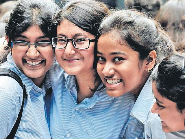 Students of South Point High School in Kolkata celebrate after the publication of the Higher Secondary examination results on Monday.