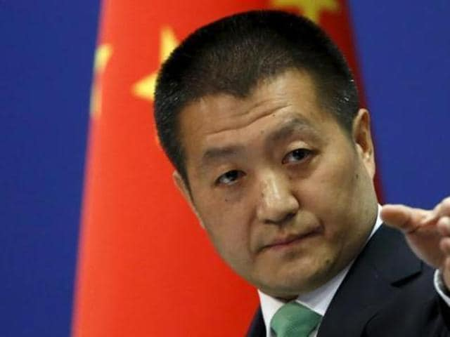 Chinese foreign ministry spokesperson Lu Kang points out a reporter to receive a question at a regular news conference in Beijing. (Reuters File Photo)