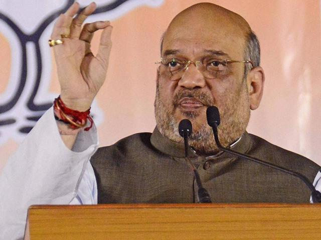 National President of BJP Amit Shah addresses a gathering during inaugural function of Karnawati Premier League (KPL) night cricket tournament in Ahmedabad on May 15, 2016.