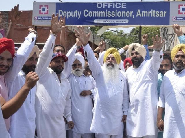 The district (rural) Congress protesting against the Punjab government outside the Amritsar deputy commissioner's office on Monday.