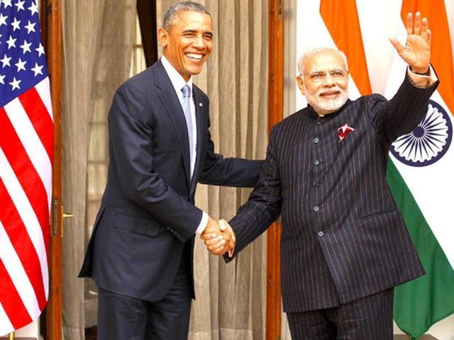 US President Barack Obama (R) and Indian Prime Minister Narendra Modi in Paris, November 30, 2015(REUTERS)