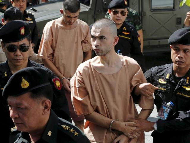 Bilal Mohammed (also known as Adem Karadag) and Yusufu Mieraili, both suspects of the Aug 17 Bangkok blast, being escorted as they arrive at the military court in Bangkok, Thailand, November 24, 2015.