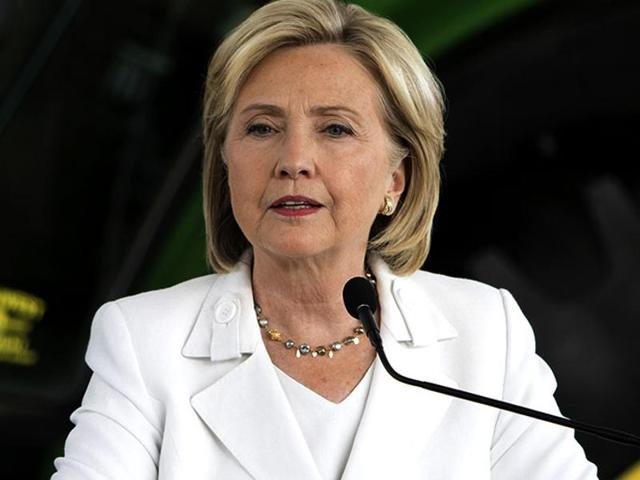 """Recalling sunnier days of growth, low unemployment and budget surpluses under her husband, Hillary Clinton is telling Americans that Bill Clinton will be """"in charge of revitalising the economy"""" if she wins the White House."""