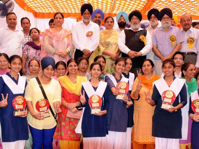 Punjab education minister Daljit Singh Cheema and higher education minister Surjit Singh Rakhra honouring students of the district who made it to the merit list of Punjab School Education Board examinations at Government Senior Secondary School, Civil lines, in Patiala, on Monday.