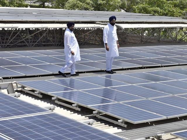 Renewable energy minister Bikram Singh Majithia (right) inspecting the rooftop solar power plant installed at Dera Baba Jaimal Singh, by the Radha Soami sect at Beas, 45km from Amritsar, after it was inaugurated by CM Parkash Singh Badal on Tuesday.(Gurpreet Singh/HT Photo)