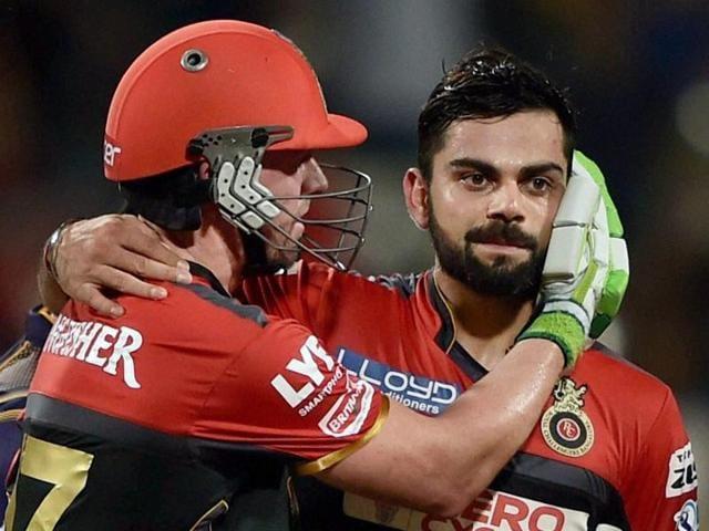 RCB batsman AB de Villiers greets captain Virat Kohli after winning the IPL Match against KKR in Kolkata.