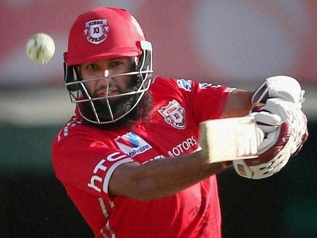Hashim Amla of Kings XI Punjab hits over the top for a boundary during the IPL match.