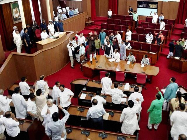 Opposition MLAs shout slogans during the budget session of Odisha assembly in Bhubaneswar.